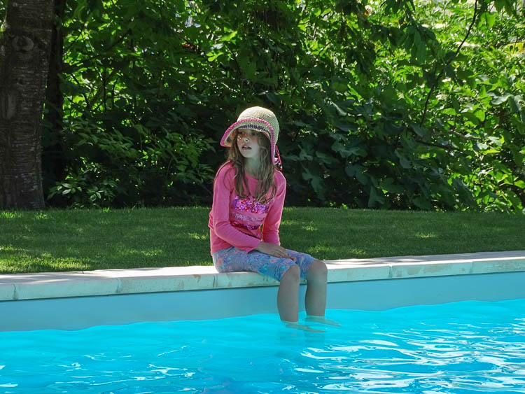 Izzy wondering whether to get into the pool, May 2015